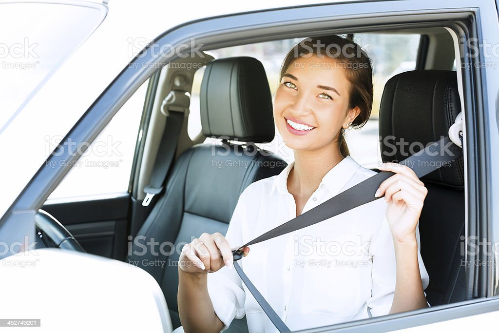 woman in a car stock photo