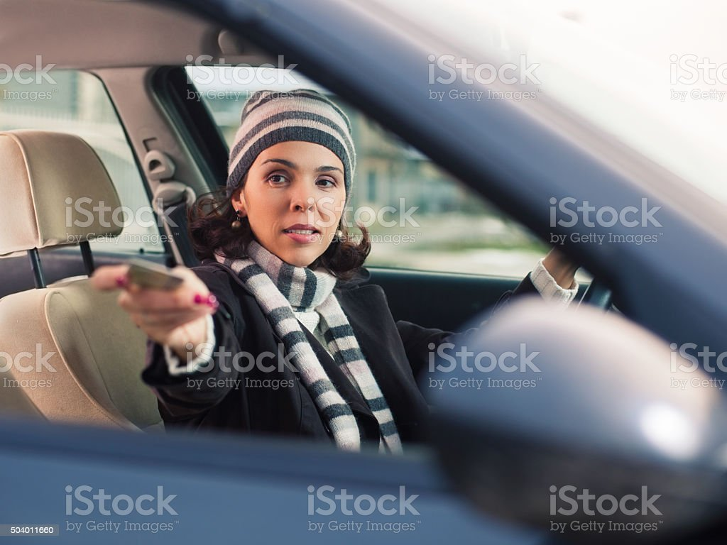 Woman in a Car Showing Her Driver's License stock photo