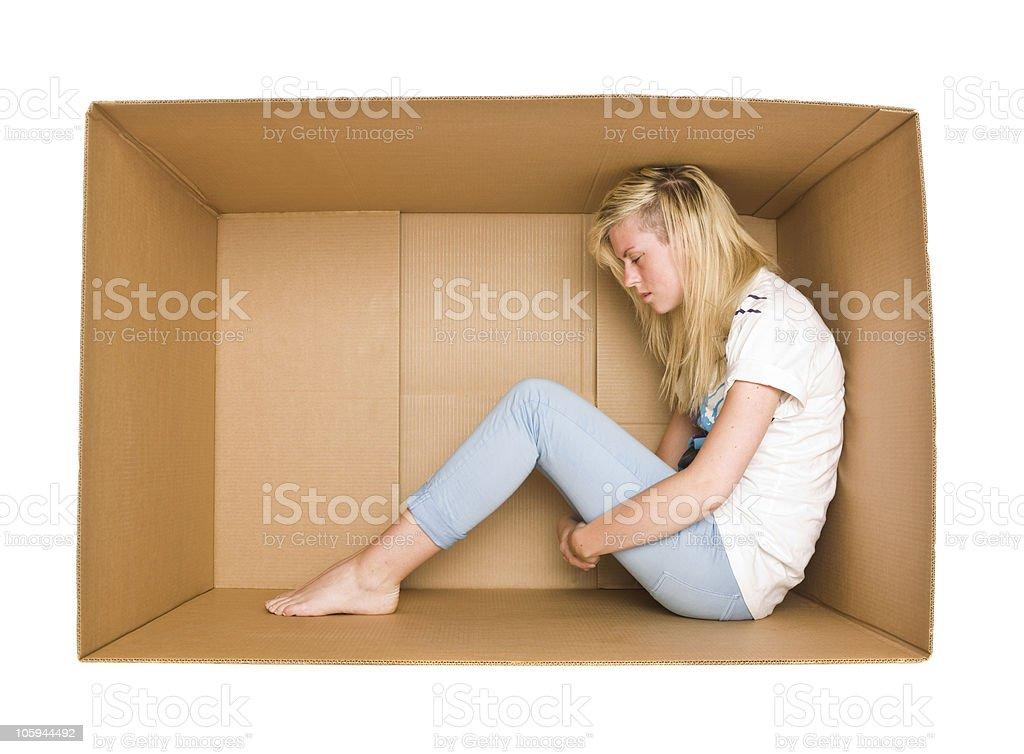 Woman in a cardboard box stock photo