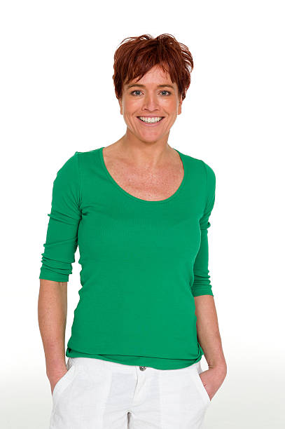 woman in a casual green top - woman green eyes red hair stock photos and pictures
