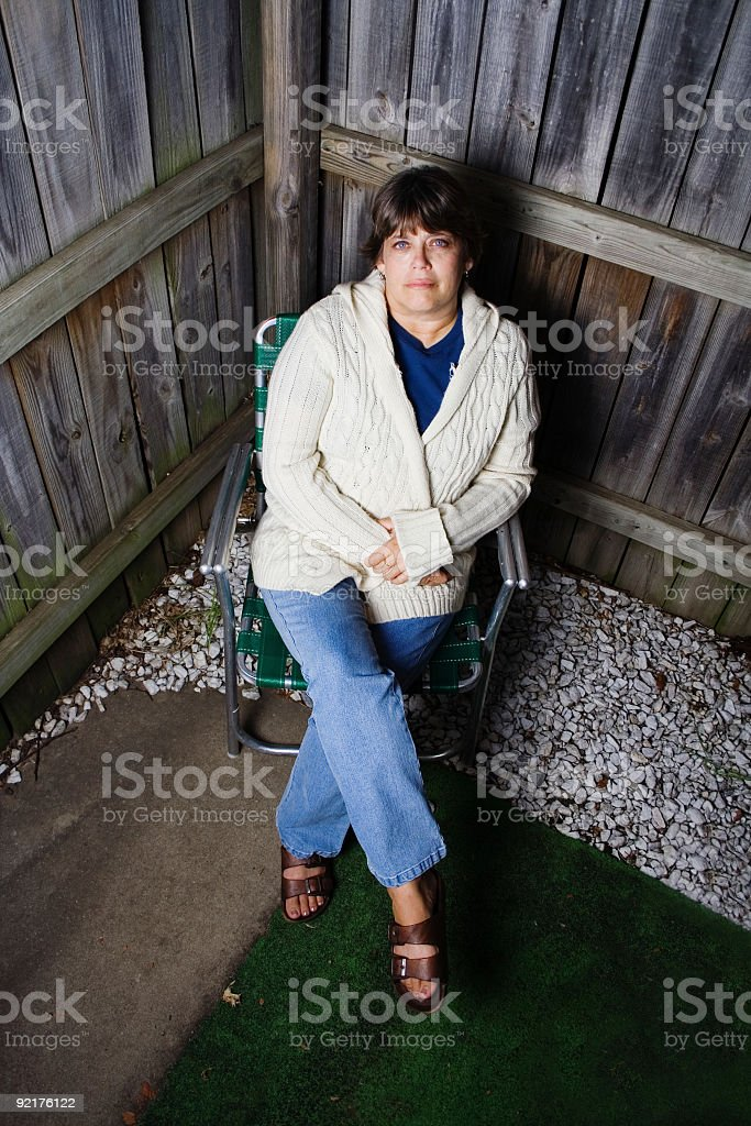 Woman in a chair stock photo