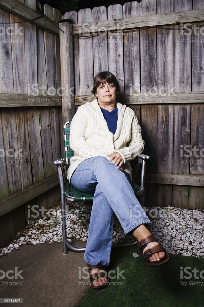 Woman in a chair royalty-free stock photo
