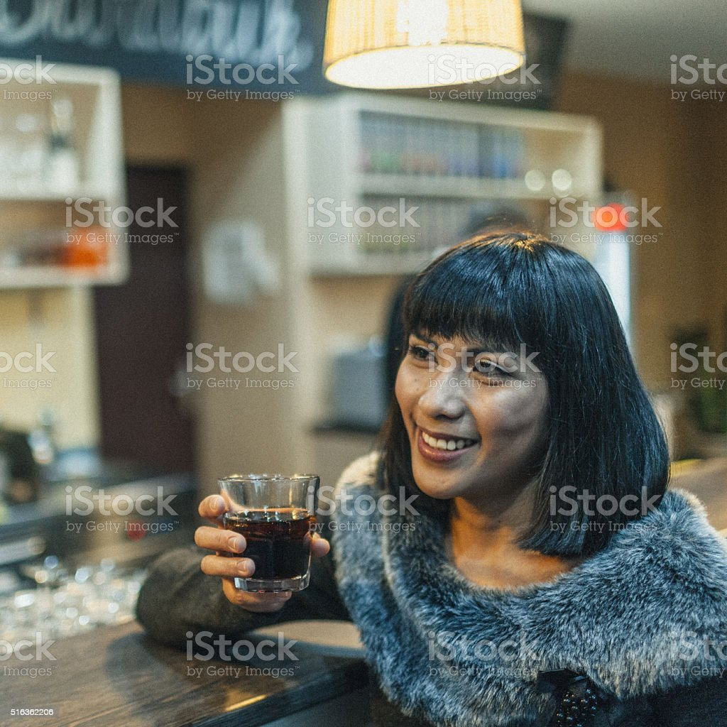 Woman in a coffee shop stock photo