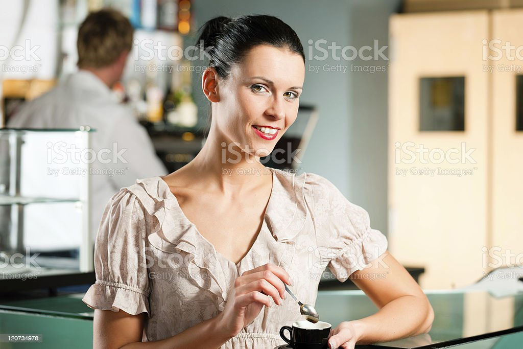Woman in a coffeeshop stock photo