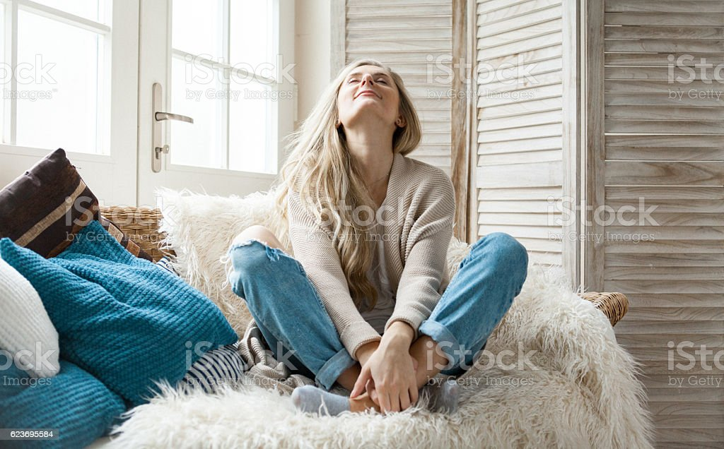 Woman in a cosy home stock photo
