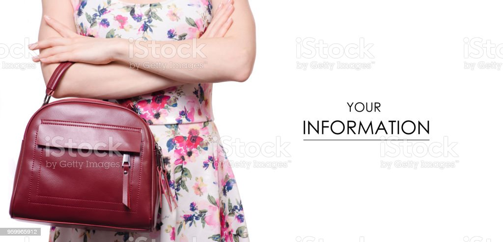 Woman in a dress in a hand a female leather red bag handbag pattern stock photo