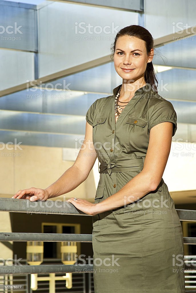 Woman in a Dress Posing Outside royalty-free stock photo