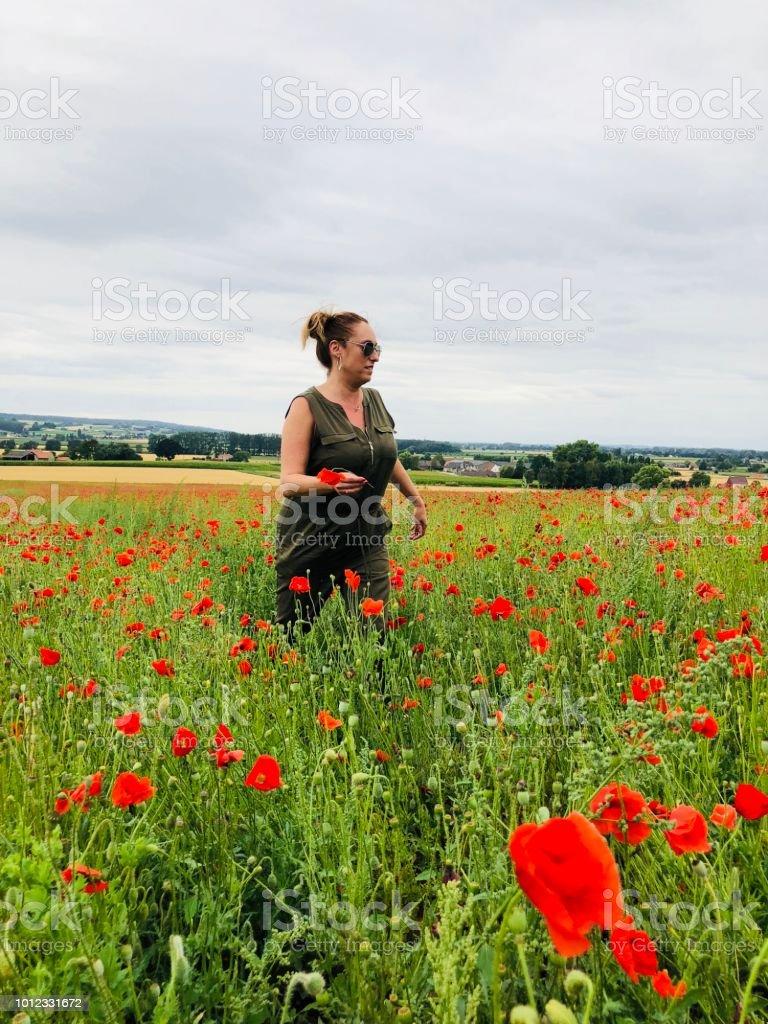 Woman In A Field Of Poppies In Flanders World War Memorial Great War