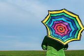 Woman in a field with umbrella