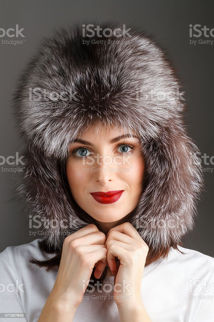 Woman in a fur hat stock photo