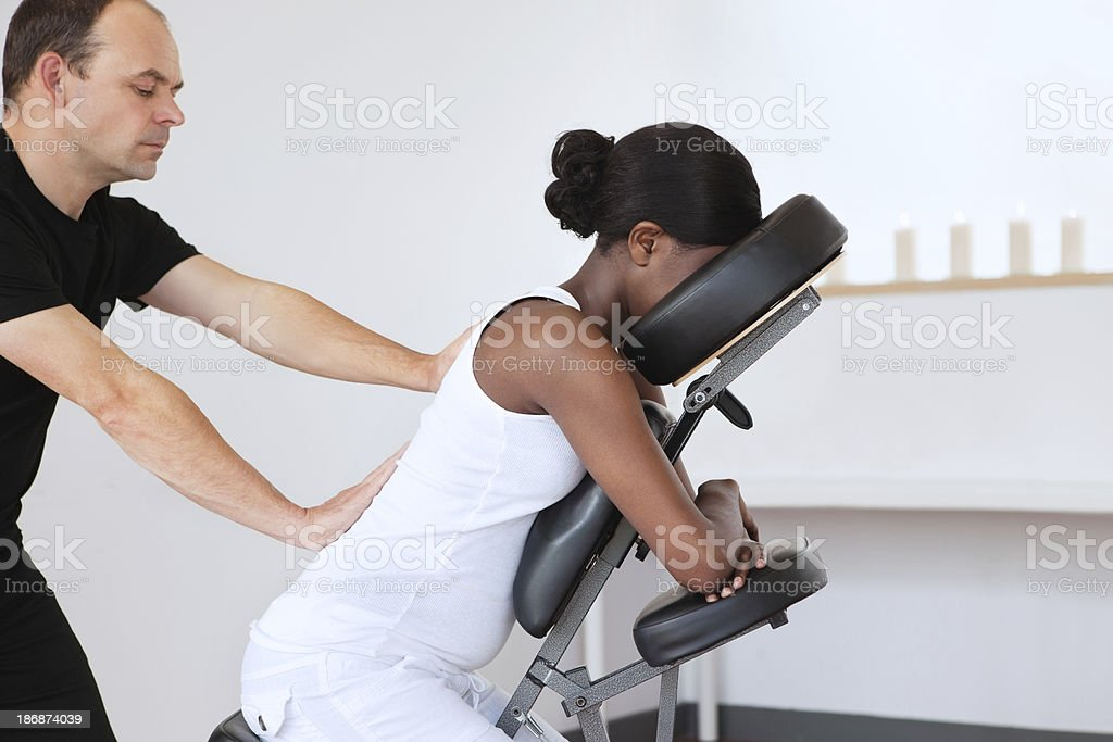 Woman in a Head Massage Chair stock photo