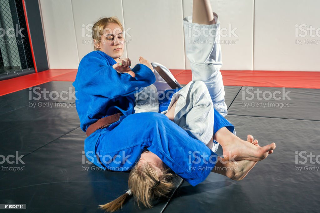 woman in a kimono makes a painful stock photo