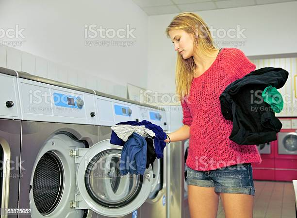 Woman In A Laundromat Shop Stock Photo - Download Image Now
