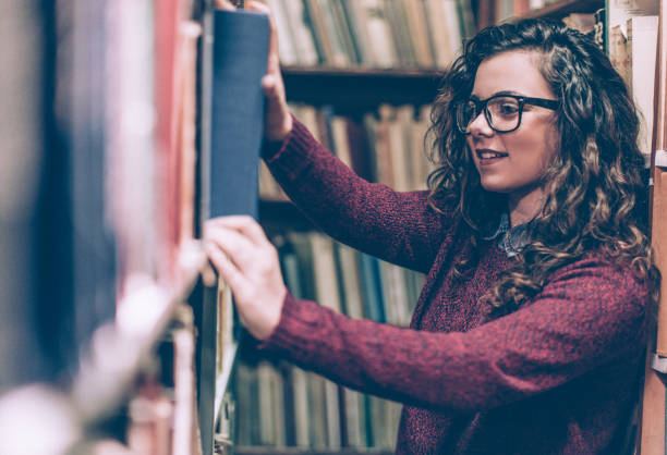Woman in a Library stock photo