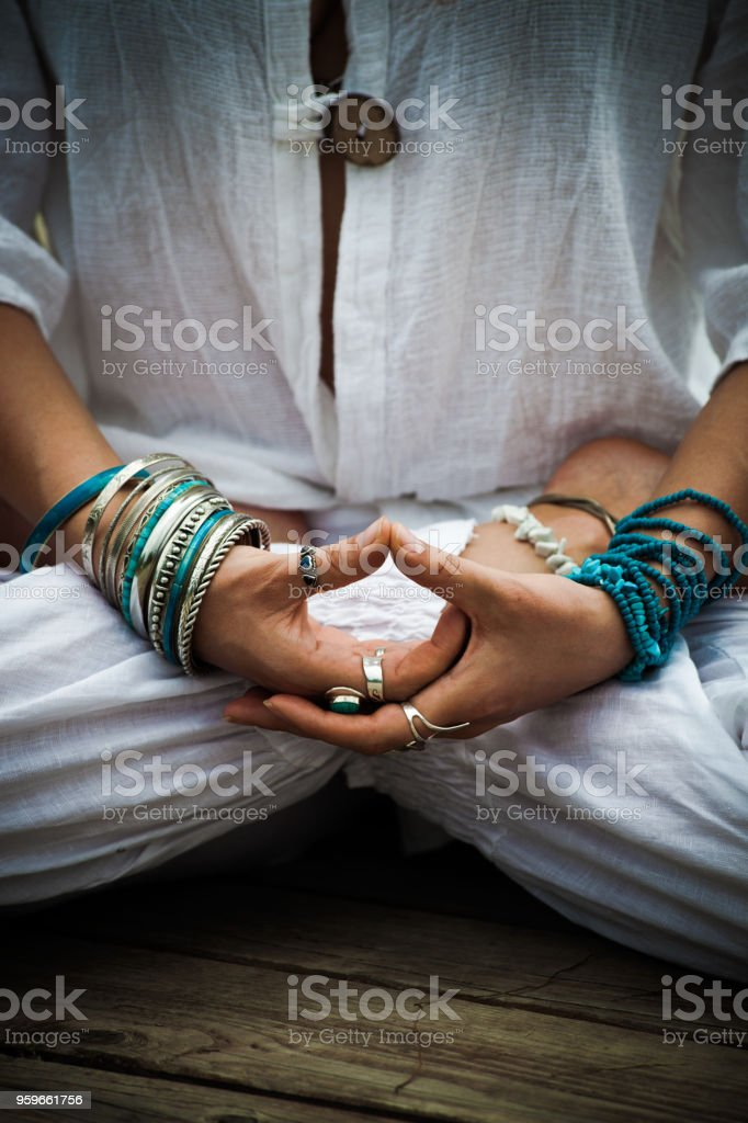 woman in a meditative yoga position outdoor stock photo