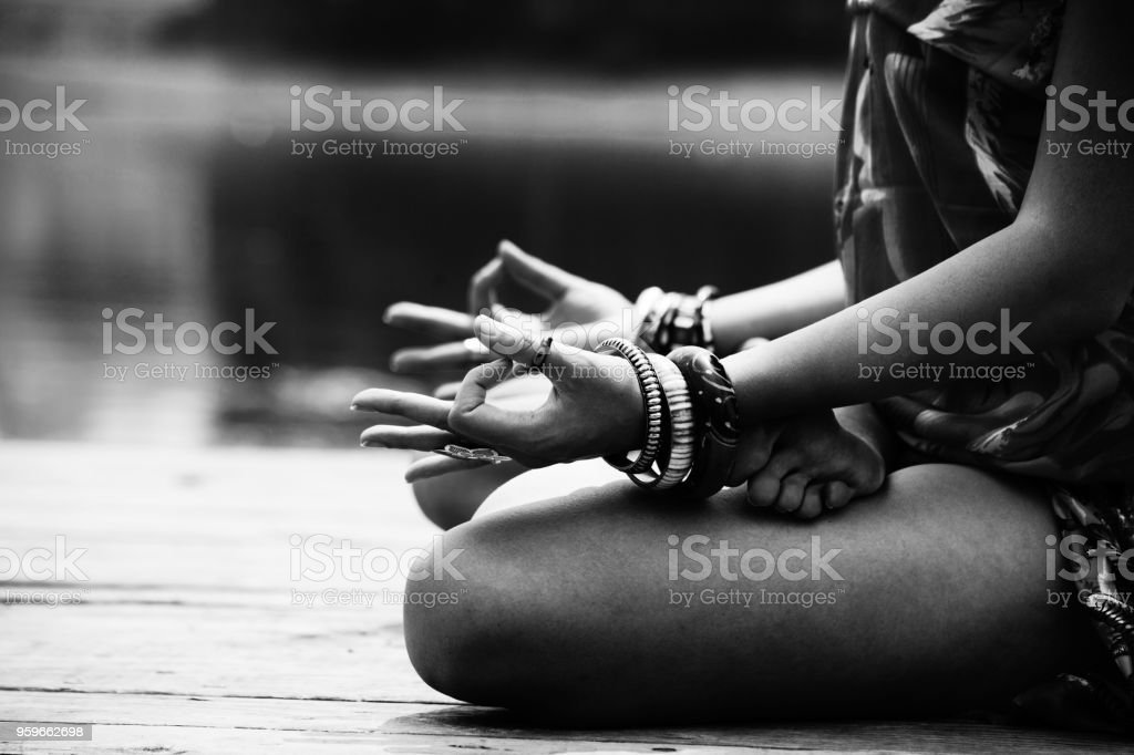 woman in a meditative yoga position stock photo