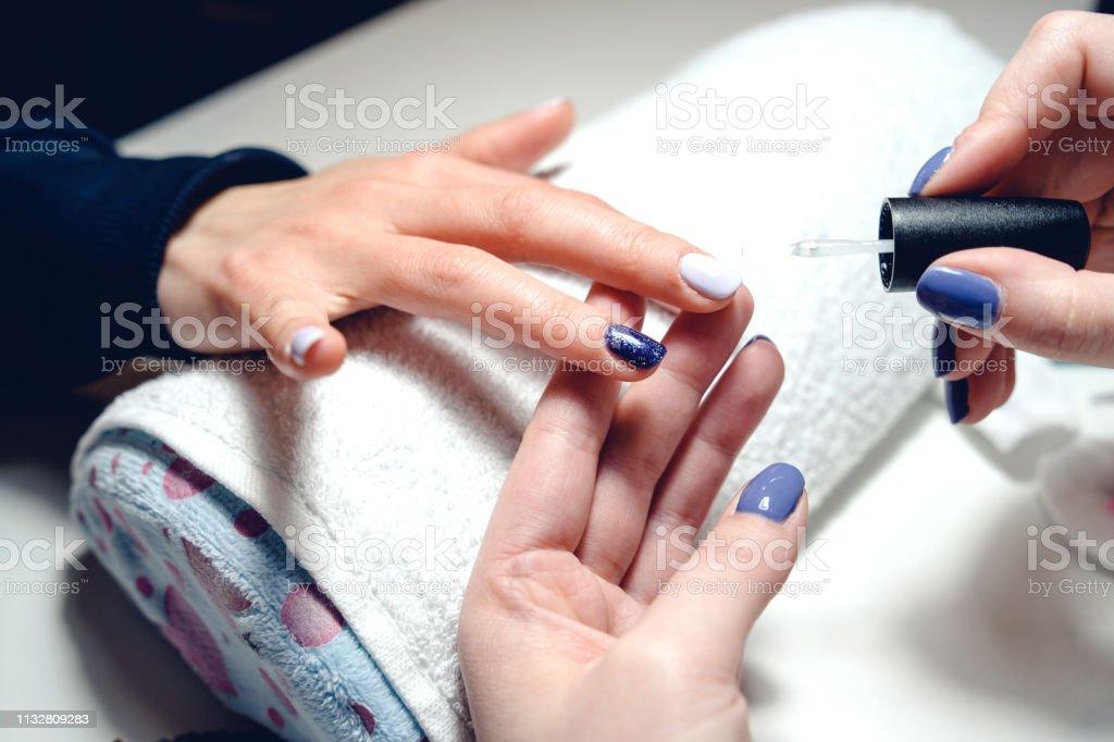 Manicure nail polish gel at the salon