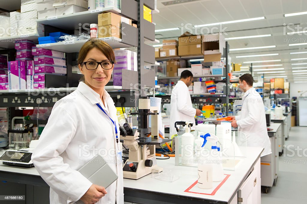 Woman in a Pharmaceutical Chemist Labratory stock photo