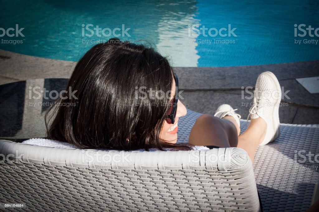 Woman in a poolside royalty-free stock photo