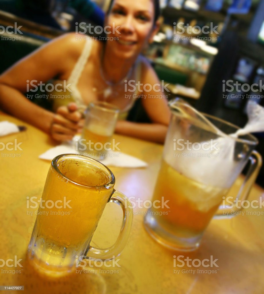 woman in a raw bar drinking beer stock photo