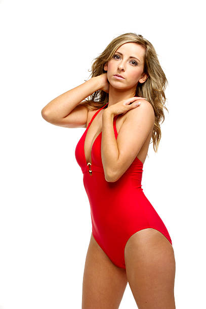 Woman in a red bathing suit stock photo