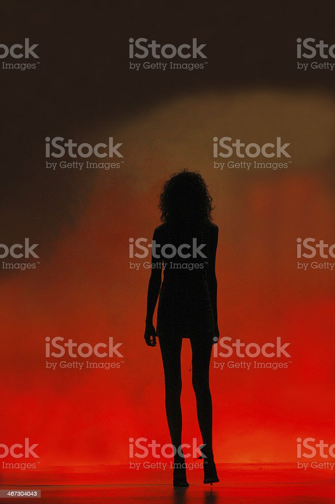 Woman in a red cloud stock photo
