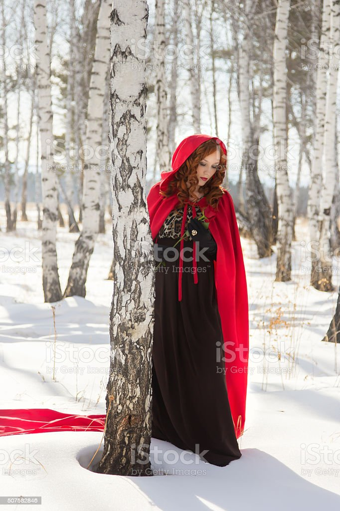 woman in a red robe stock photo