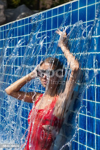 1155046257istockphoto woman in a red swimsuit in swimming pool 584606604