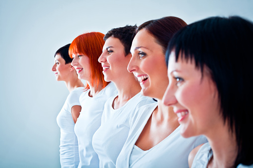 Woman In A Row Stock Photo - Download Image Now