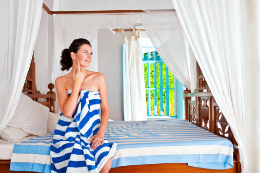Woman In A Rustic Bedroom Stock Photo - Download Image Now