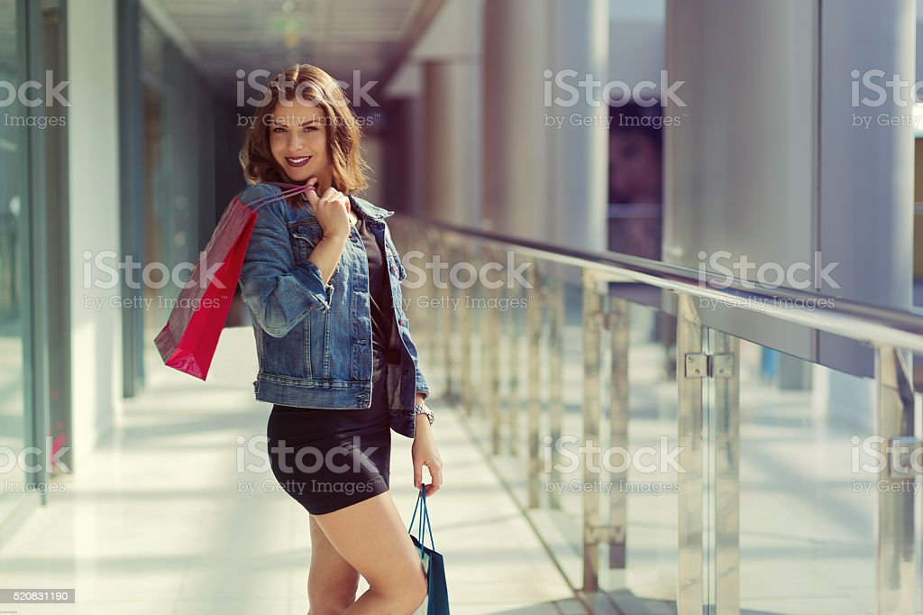 Woman in a shopping mall Pretty stylish woman walking in a shopping mall Adult Stock Photo