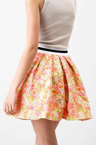 woman in a short multicolor skirt - lange gestreifte röcke stock-fotos und bilder