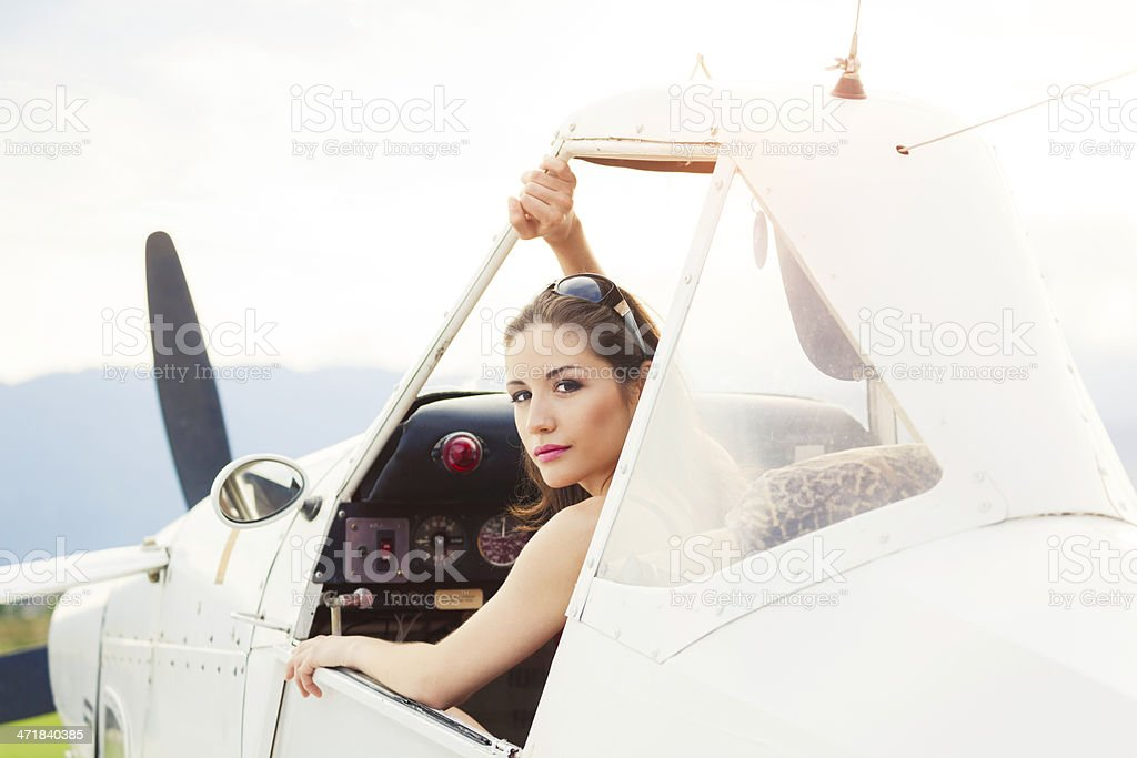 Woman in a small airplane. royalty-free stock photo