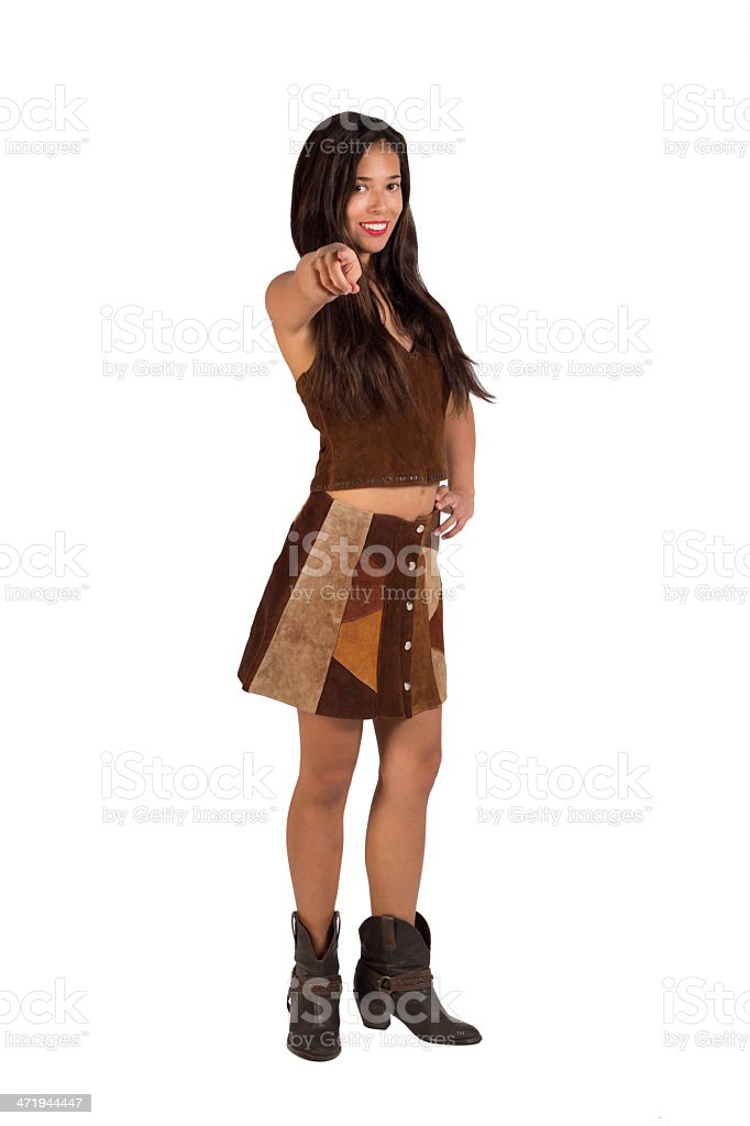 Woman in a Suede Outfit Pointing at Camera stock photo