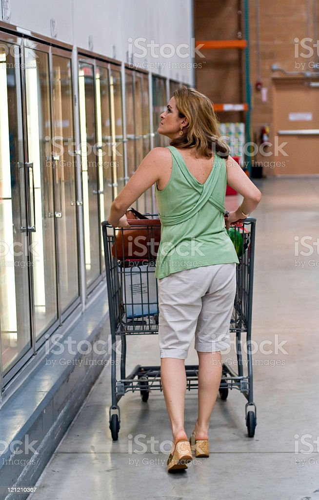 Woman in a supermarket royalty-free stock photo
