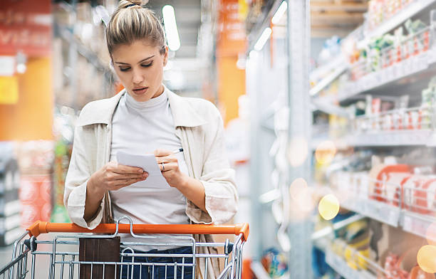 woman in a supermarket. - consumer products stock pictures, royalty-free photos & images