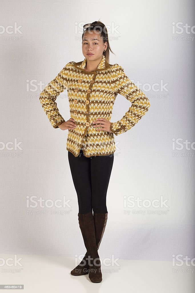 Woman in a Sweater with Hands on Hips stock photo