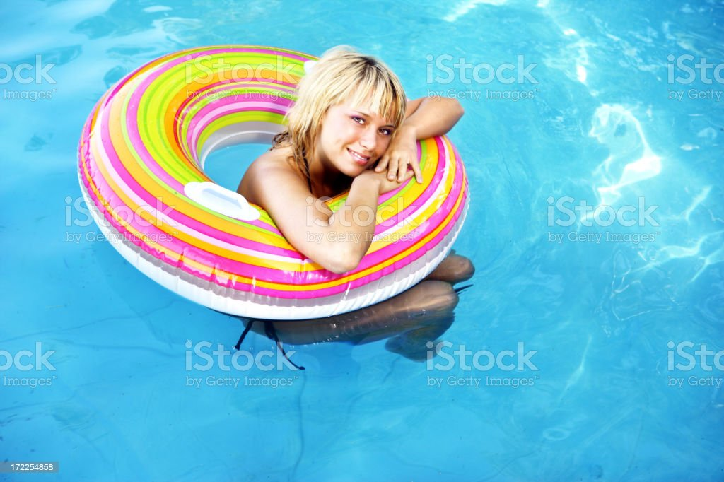 Woman in a swimming pool royalty-free stock photo