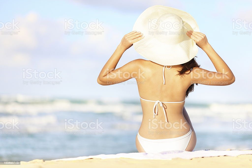 A woman in a swimming suit on a beach stock photo