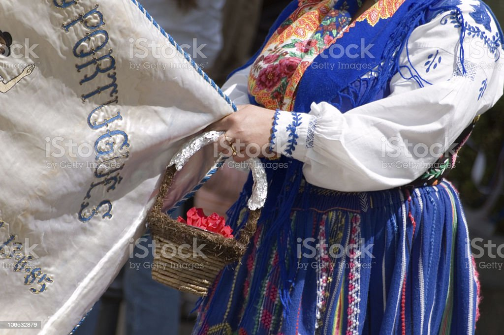 Woman in a traditional Portuguese costume holding basket royalty-free stock photo