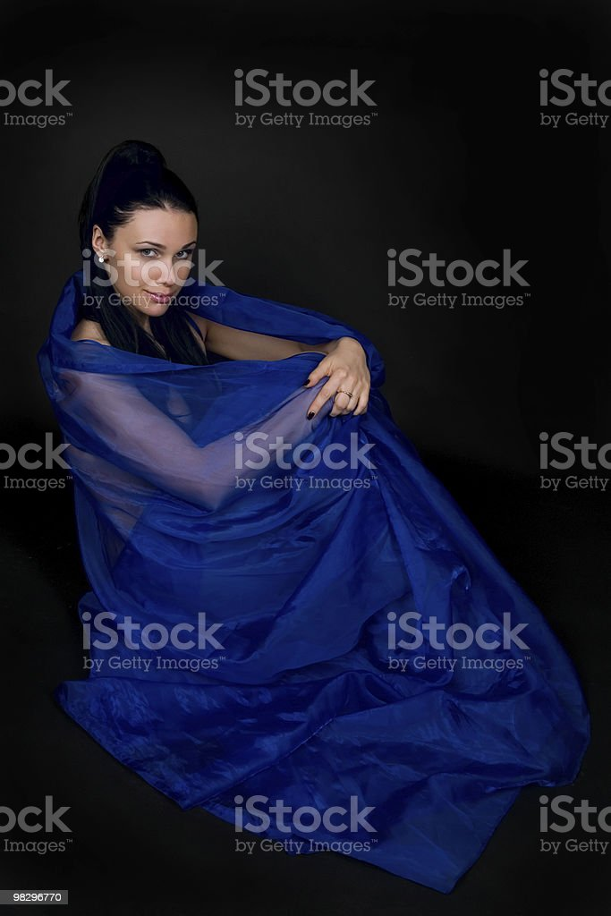 Woman in a transparent dark blue cape royalty-free stock photo