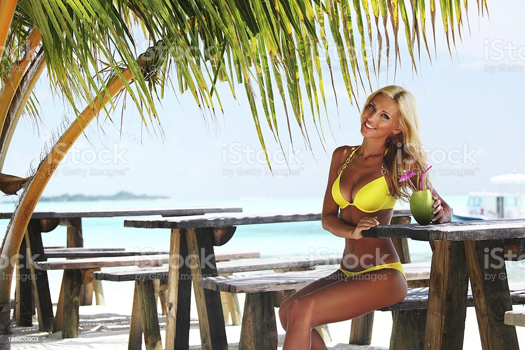 woman in a tropical cafe royalty-free stock photo
