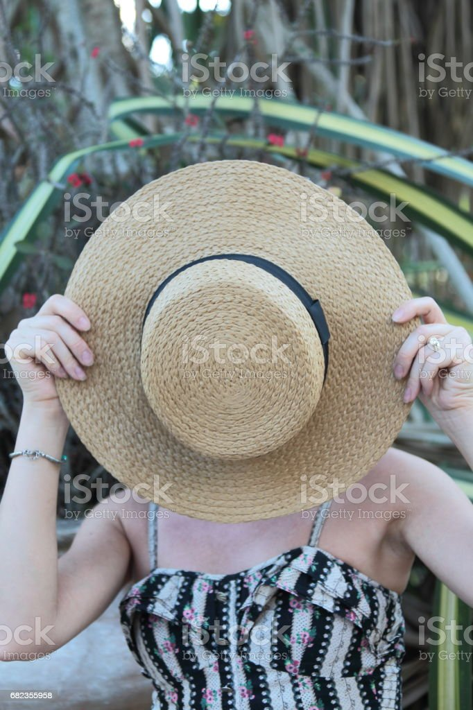 Woman in a tropical park. royalty free stockfoto