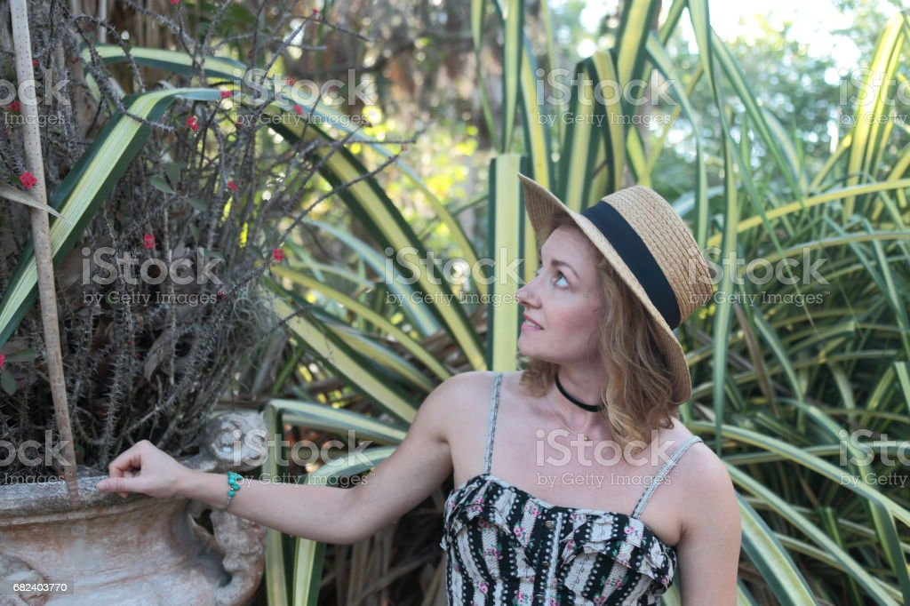 Woman in a tropical park. royalty-free stock photo