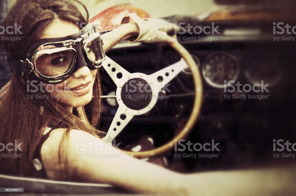 Woman in a vintage car stock photo
