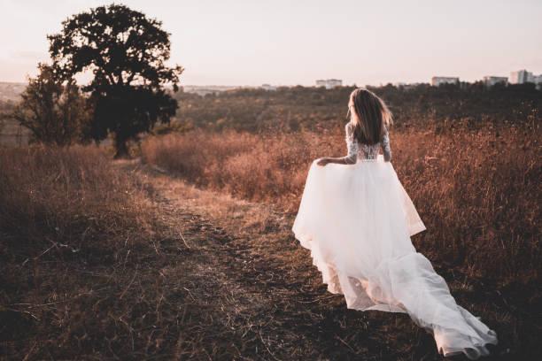 Woman in a wedding dress stock photo