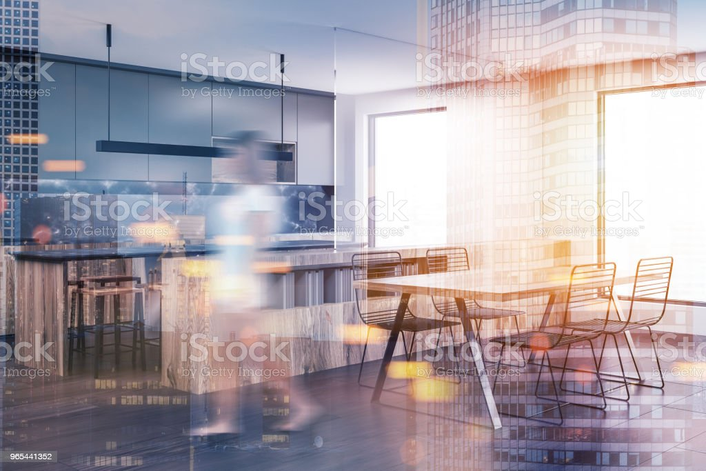 Woman in a white and black kitchen corner royalty-free stock photo