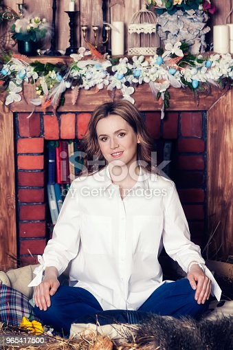 A Woman In A White Shirt Is Sitting On The Floor Smiling And Looking At The Camera Stock Photo & More Pictures of Adult