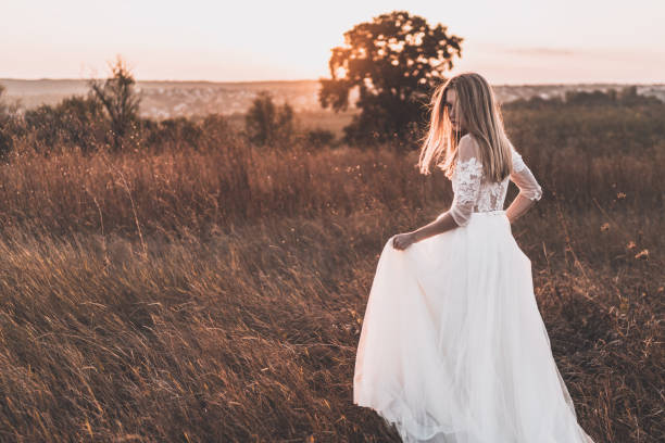 A woman in a white wedding dress stock photo