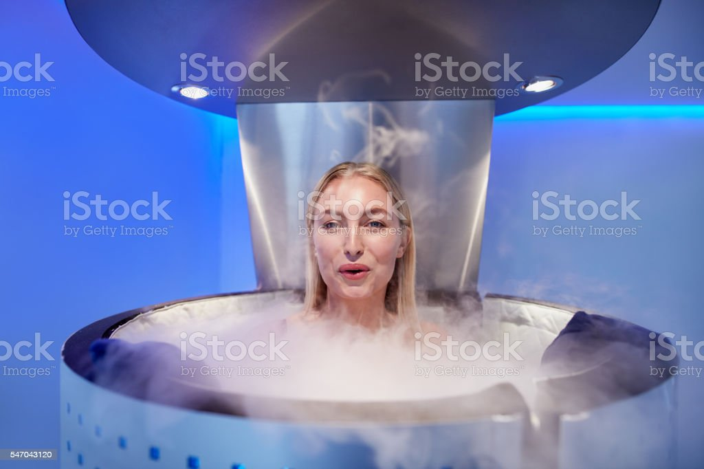 Woman in a whole body cabin stock photo